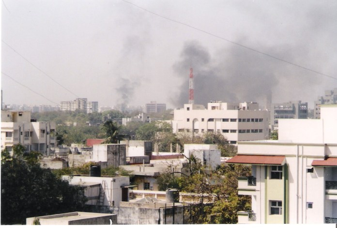 A mob stormed Gulbarg Society residential complex in Ahmedabad in 2002 and targeted Muslims during riots that swept state then led by Narendra Modi. The skyline of Ahmedabad filled with smoke as buildings and shops are set on fire by rioting mobs