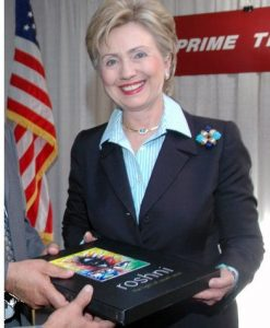 Hilary Clinton receives the book