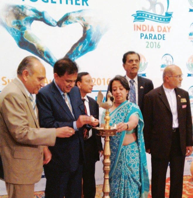Ambassador Riva Ganguly Das and FIA officials light the lamp to kick off the 36th India Day Parade, scheduled for August 21