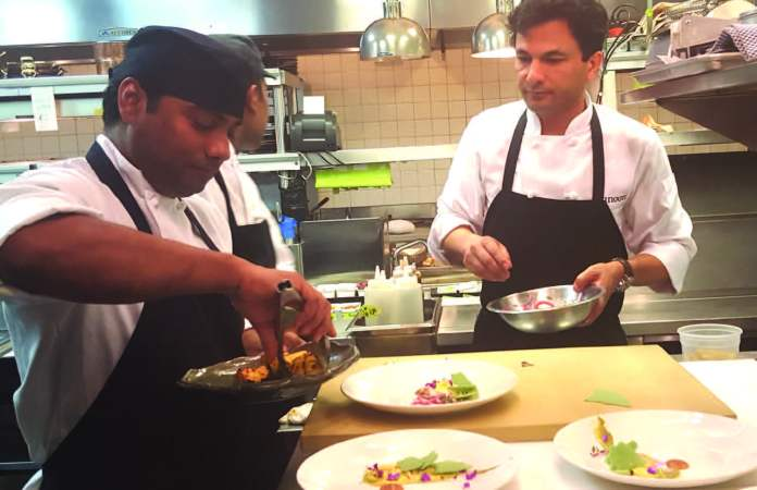 Dheeraj Tomar with celebrity Chef Vikas Khanna (right)