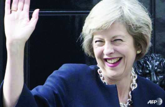 Britain's new Prime Minister Theresa May waves outside 10 Downing Street in central London on Jul 13, 2016, the day she takes office following the formal resignation of David Cameron.