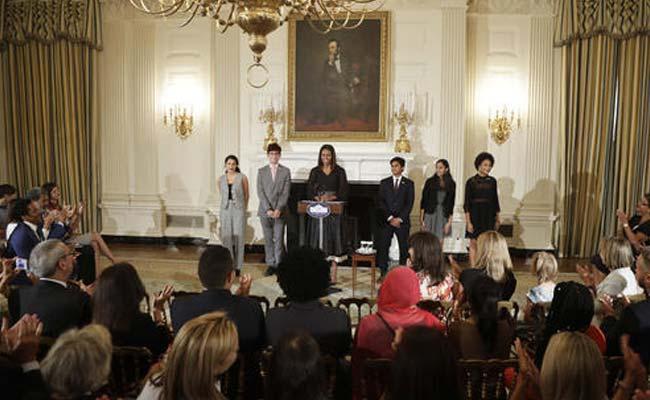 Michelle Obama with Maya Salameh, Joey Reisberg, Gopal Raman (second from r) and Maya Eashwaran (r). (AP)