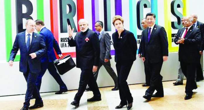 India's Prime Minister Narendra Modi is hosting leaders of the world's most populous and powerful emerging economies over the weekend. They would be looking for ways to bolster their club and ease tensions among them.Picture shows BRICS leaders at the summit in Ufa, Russia