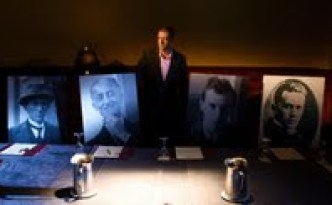 Diarmuid Ferriter with enlarged photographs in the Mansion House