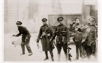 National Army troops just as the Four Courts in Dublin explodes. Note the Thompson submachine guns.
