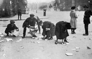 People pick over historical documents from the destroyed Four Courts in Dublin in 1922. More recently historians have fought new battles over the issues of that period.