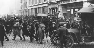 A Auxiliary patrol dismounts amid an unruly crowd in Dublin, 1921.