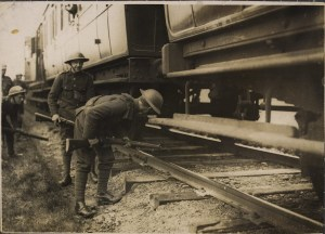British soldiers in Kerry check under a train.