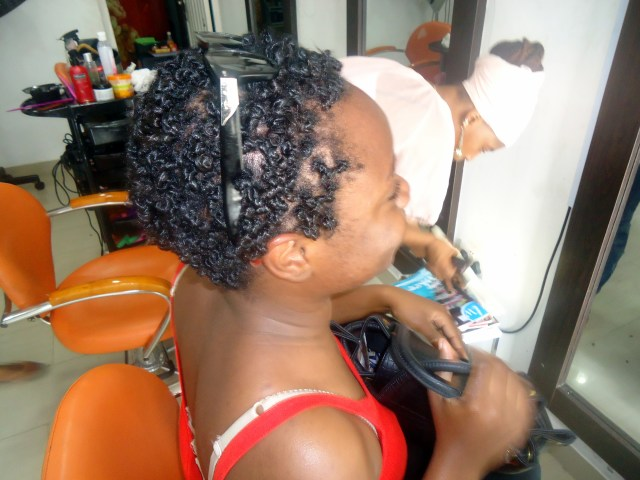 My friend T: mini twists on transitioning hair, curled with perm rods.