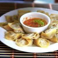 Momo - Nepali style steamed dumplings with hot tomato chili sauce