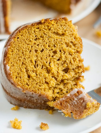 This Pumpkin Spice Latte Cake recipe is the absolute best! Delicious pumpkin spice and subtle coffee flavor combine into the most moist, addictive cake you'll find. Best of all, it's a cake mix hack so it's super easy to make (and your guests will never know that it's not completely homemade!). This is the quintessential fall dessert and the perfect alternative to pie on any Thanksgiving or holiday dessert table!