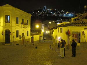 A view of one of the streets close to La Ronda with a night view of the Madonna on El Panecillo.