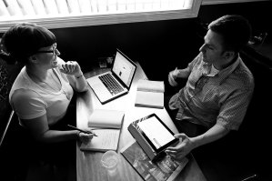 Stephanie and Matt plan out the final issue of The Paper at Zanzabar. Photo by Hunter Wilson/Kertis Creative.