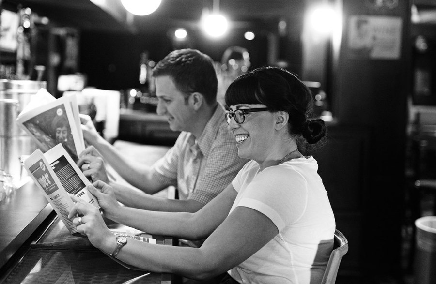 Stephanie and Matt pretend to read back issues of The Paper. Photo by Hunter Wilson/ Kertis Creative.