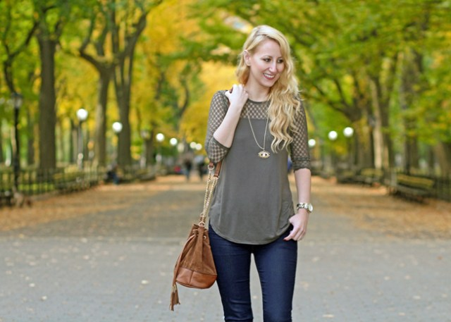 Wearing olive crochet top, jeans, and brown bucket bag, for fall in Central Park