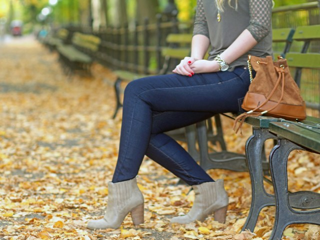 Fall outfit details: Dynamite blue jeans, brown bucket bag, and taupe ankle boots