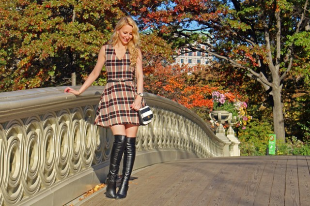 Plaid dress, striped bag, and over-the-knee boots