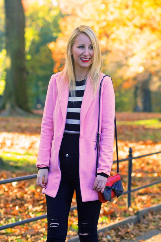Pink coat and red Kate Spade bow bag in Central Park