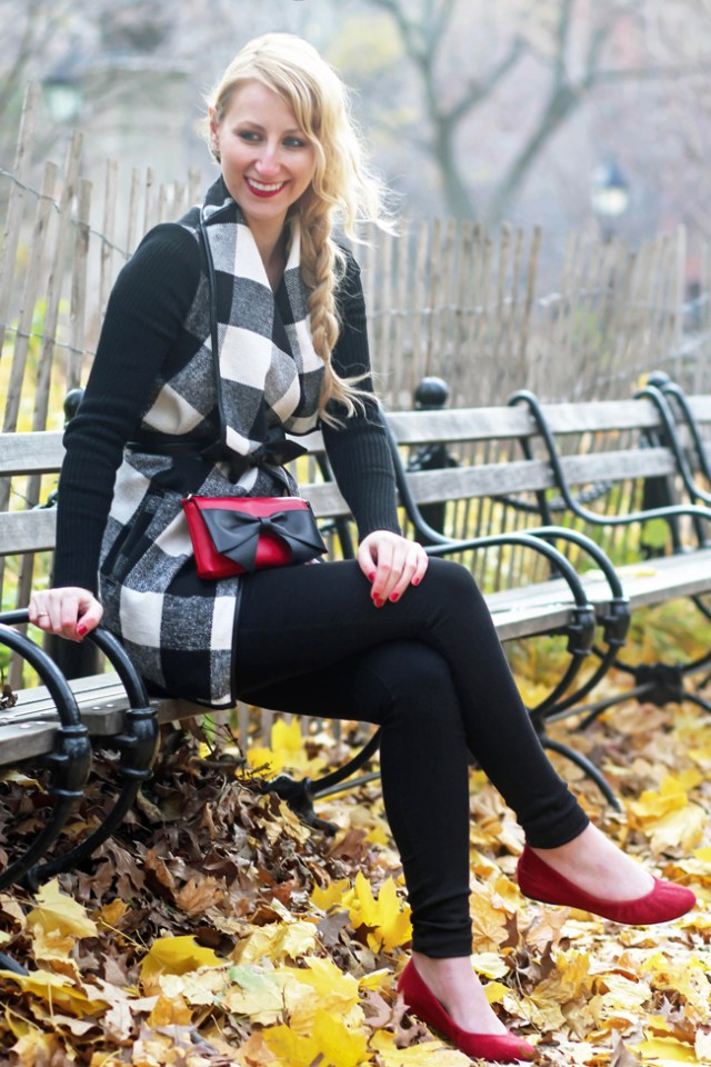 Megan Knight wearing plaid coat with red flats and red Kate Spade bag
