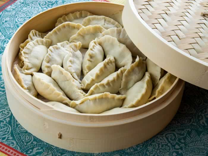 Chinese Bamboo Steamer Filled with Potstickers