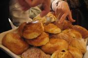 A waiter serves a piece of just-baked sweet bread at El Cardenal, a restaurant in Mexico City's Centro Historico