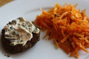 Homemade black bean burgers with cilantro-chipotle mayo and ginger-ccarrot slaw