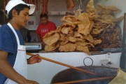 A butcher-shop employee makes homemade chicharron in Zacatlan, Puebla