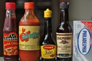 An array of Mexican (and honorarily Mexican, in the case of the cream cheese) condiments