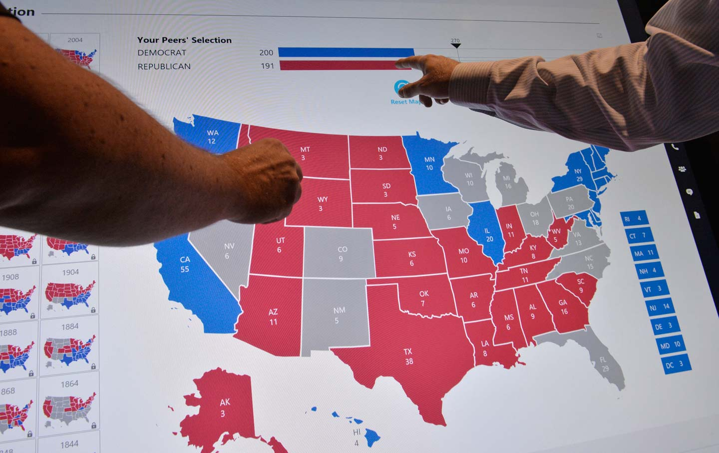 The Clinton Trump Electoral Map Looks Almost Exactly Like the Obama     Delegates point to an electoral map at the Democratic National Convention   Philadelphia  Pennsylvania  July 27  2016   Reuters   Charles Mostoller