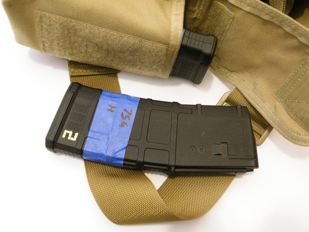 A double mag pouch serves to let me haul more ammo, or makes use as a multipurpose pouch for other items such as the Solo R/T