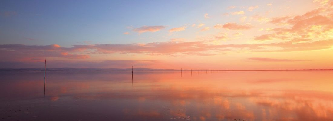 The Pilgrims Way Sunset at High Tide Holy Island