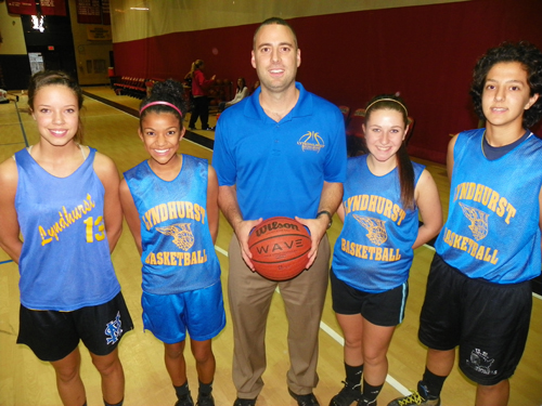 Photo by Jim HagueThe Lyndhurst girls' basketball team won 16 games last year and looks for more this year. From l. are Lexus Lopez, Brittany Levario, head coach Perrin Mosca, Dana Halligan and Camila Alonso.