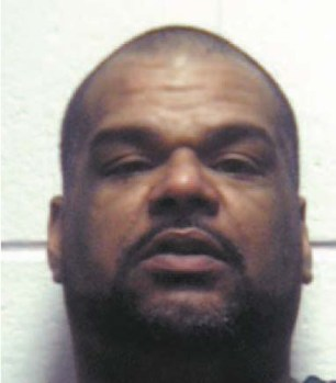 Cruz Martinez Jr., accused of the murderat 253 Belgrove Drive (below)