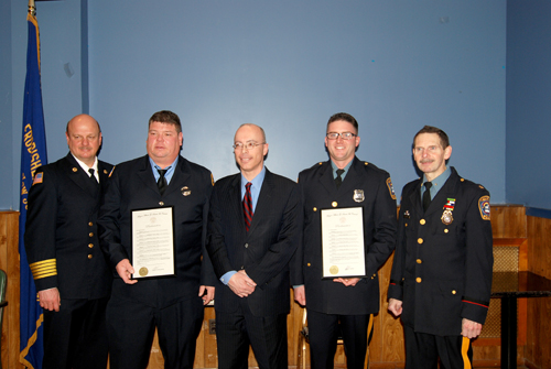 Photo by Det. Ray Lopez, KPD Shown at awards ceremony at American Legion Post 99 last Friday are (l. to r.): KFD Chief Steve Dyl; Thomas Atwell, Firefi ghter of Year; Kearny Mayor Alberto Santos; John Fabula, Police Offi cer of Year; and KPD Chief John Dowie.