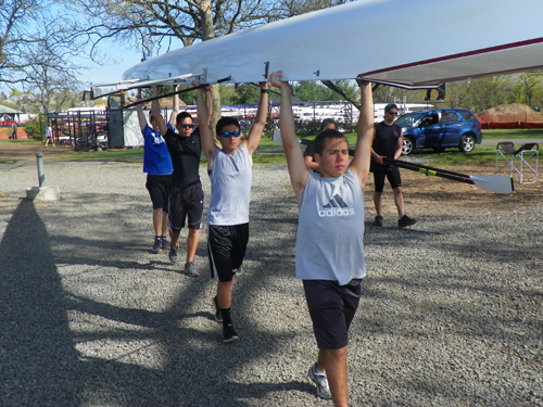 Photo by Al Perez The North Arlington novice 4 team, namely from back to front, Vinny Ribeiro, Bryan Ugaz, Nathaniel DeLeon and Jose Antunes, carry their boat toward the Passaic River for crew practice recently.