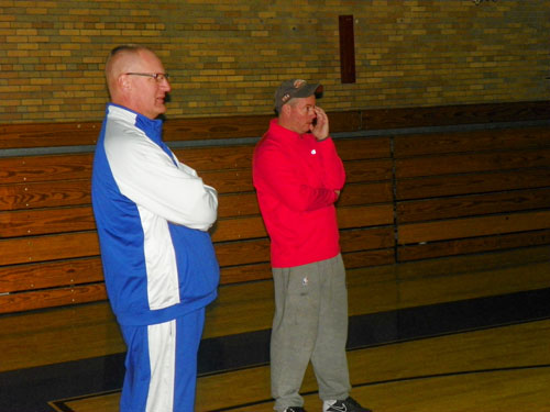 Photo by Jim Hague North Arlington coach Dave Walsh (l.) surveys a practice with New York Knicks radio analyst Brendan Brown, a longtime friend who came to an NA practice every year. Walsh announced his resignation last week after 10 years at NA.