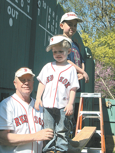Photo by Ron Leir Steven Turowski with grandchildren Jason, 4, (c.) and Stevie, 8, in front of the Nutley version of the Green Monster.