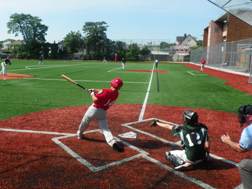Photo by Jim Hague Catcher T.J. Witt unleashes a single during the Kearny summer baseball team's game Saturday against Rutherford.
