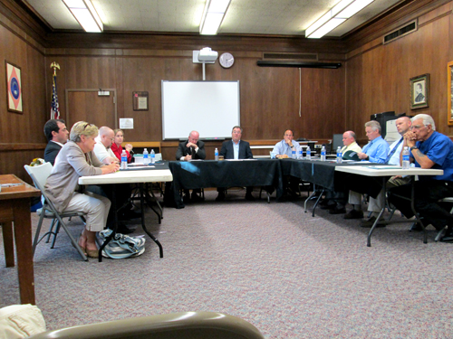 Photo by Ron Leir Kearny Board of Education members tussle over who should occupy the president's seat.