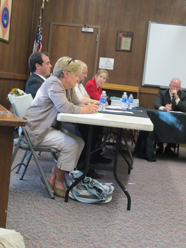 Photo by Ron Leir Bernadette McDonald (in foreground) awaits outcome of vote on presidency. To her right are: Trustees Dan Esteves, James Doran Jr. and Cecilia Lindenfelser and Counsel Ken Lindenfelser.