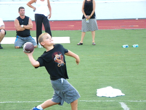Photo by Jim Hague Seven-year-old Vincent Richard throws the football during the Kearny football camp.