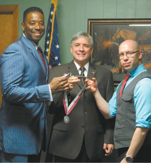 Photo by Ron Leir Commissioner Steven Rogers (c.), Courtney Johnson (l.) and Dan Jacoby display Nutley's WWII veterans medal.