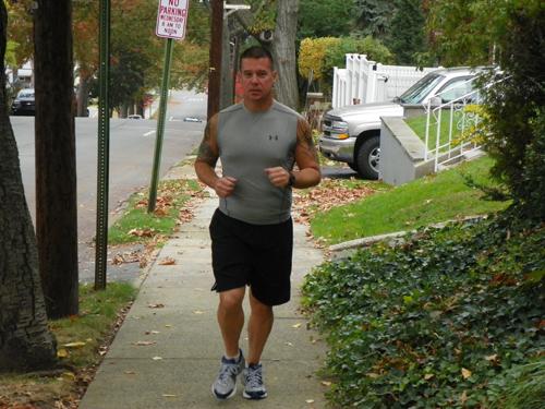 Photo by Jim Hague Kearny firefighter Doug Boyle trains near his home in Kearny, preparing for the New York City Marathon.