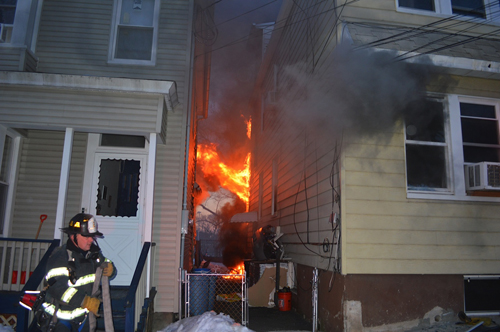 Photos courtesy Andrew Taylor KFD at Dukes St. fi re scene where pet pup was rescued and revived.