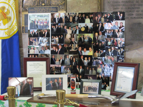 Photo by Ron Leir Town Hall photo display in tribute to the late Mayor Raymond McDonough.