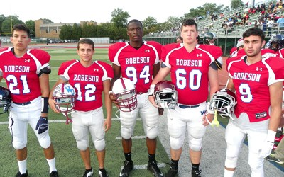 Photo by Jim Hague From l., Michael Ramirez of Belleville, Nick Restaino of Bloomfield, Victor Olapinsin of Bloomfield, Kevin Davis of Nutley and Peter Russo of Nutley were all on the winning East All-Star squad, who defeated the West, 28-8, in the 22nd annual Paul Robeson All-Star Football Classic at Robeson Stadium in East Orange last Tuesday.