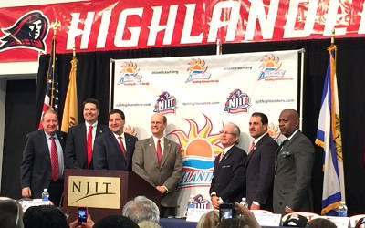 Photo by Jim Hague From left, former New Jersey Gov. Richard Codey, men's basketball head coach Jim Engles, athletic director Lenny Kaplan, Atlantic Sun commissioner Ted Gumbart, school president Joel Bloom, State Sen. Paul Sarlo and Newark Mayor Ras Baraka all celebrate NJIT's entrance into the Atlantic Sun Conference, ending the school's stint as the lone NCAA Division I independent.