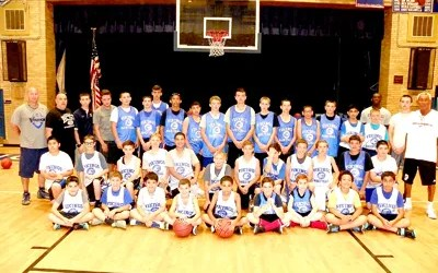 Photo by Jim Hague The initial group of the North Arlington basketball camp gathered for a group picture last week, under the guidance of high school head coach Rich Corsetto (far r.).
