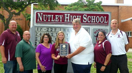 Photo courtesy Jim Hague Nutley's Carly Anderson (c.) receives her 2014-2015 Observer Female Athlete of the Year award from sports writer Jim Hague in front of Nutley High School. From l., are Nutley athletic director Joe Piro, Carly's parents, Harry and Christy Anderson, Anderson, Hague, head softball coach Luann Zullo and head girls' basketball coach Larry Mitschow.