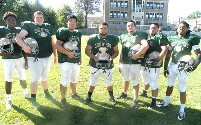 Photo by Jim Hague The Queen of Peace football program looks to stay afl oat with the help of an offensive line. From l. are Desean Brickhouse, Chris Cody, Harry Moon, Ismael Alvarado, Adrian Klein, Dominic Guinto and Keyon Means-Bowman.